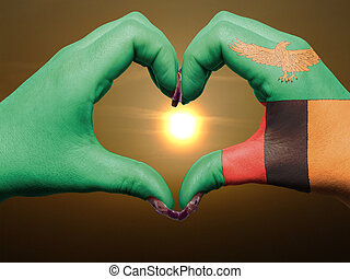 Tourist made gesture by zambia flag colored hands showing...