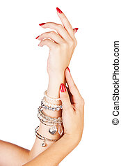 woman wearing bracelets - closeup hands of young woman with...