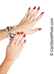 woman with manicure and bracelet - closeup hands of young...