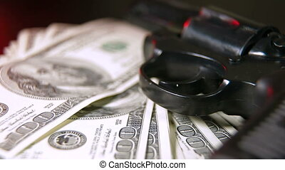 Gun And Cash - Gun and Cash Illuminated By Red Flashing...