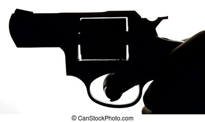Silhouette Of Hand With Gun On White Background, Closeup