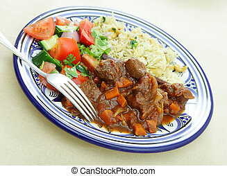 Moroccan beef tagine meal - A beef tagine stew meal served...
