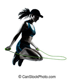 woman runner jogger jumping rope - one caucasian woman...