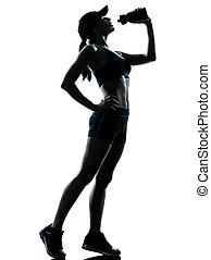 woman runner jogger drinking - one caucasian woman runner...