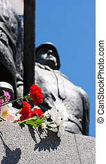 flowers near the monument on victory day