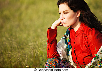 woman in field - mature woman in gypsy style clothes outdoor...