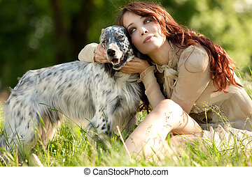 frienship - pretty woman and her dog enjoy in summer day in...