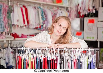 clothes shop - woman shop assistant or retail seller.