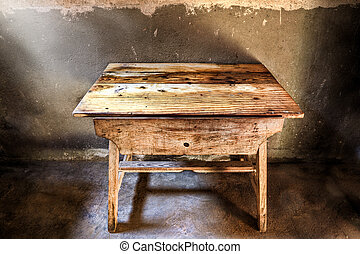 Antique wood table - Old wood table in a darkened room...