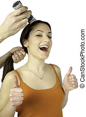 Girl getting hair buzzed happy