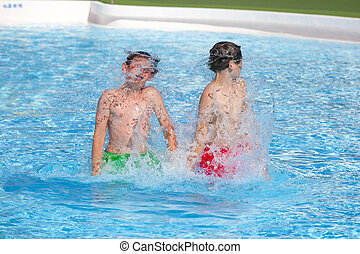 brothers playing together in the pool