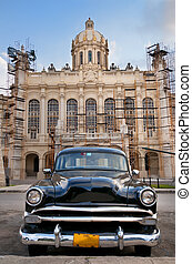 Old car parked in Havana street - Old american car parked in...