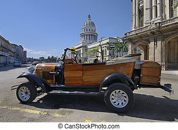 vintage style car in front of capitol building in Havana -...