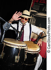 Cuban percussionist isolated on black - Portrait of young...