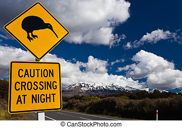 Kiwi Crossing road sign and volcano Ruapehu, NZ - New...