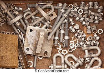 Assorted metal hardware for maintenance work consisting of a...