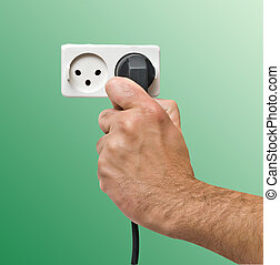 Hand inserting power plug to socket