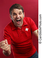 Screaming Swiss sports fan - Photo of a male Swiss sports...