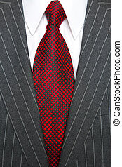Grey pinstripe suit and tie