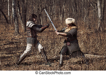 Warriors - Men in russian panoply fighting in forest