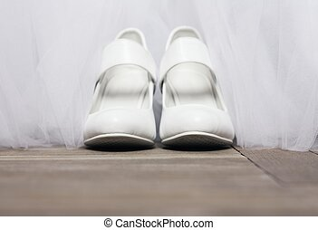 Bridal shoes - Pair of white wedding shoes on the floor in...