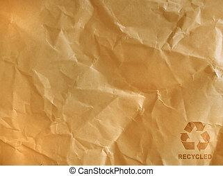 brown crumpled paper - recycle sign on brown crumpled paper