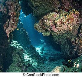 Underwater cavern with sunlight - View through an underwater...