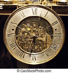 Old astronomical clocks - Old gilded astronomical clocks in...