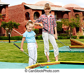 Kids playing in park - Children playing in golf Outdoor