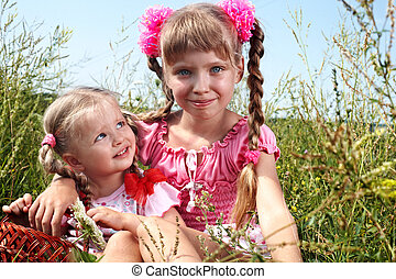 Group of child girl in green grass.