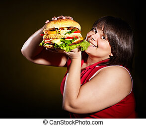 Woman eating hamburger - Overweight woman eating hamburger
