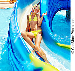 Child on water slide at aquapark Summer outdoor