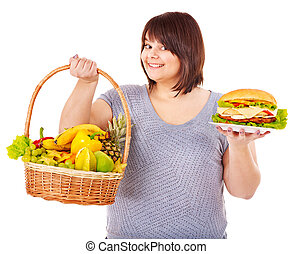 Woman choosing between fruit and hamburger Isolated