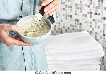 Woman add sea salt into bath. - Young woman add sea salt...