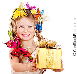 Child holding gift box. - Little girl with butterfly holding...