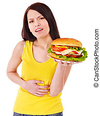 Woman holding hamburger - Woman get abdomen pain after...