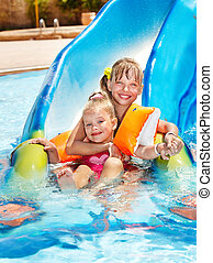 Children on water slide at aquapark Summer holiday