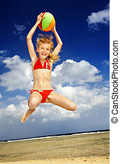 Kid playing on beach with ball. - Child playing on beach...