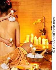 Woman getting thai herbal massage ball - Young woman getting...
