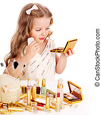 Child cosmetics Little girl applying make up