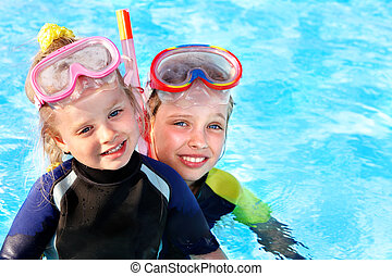Kids in swimming pool learning snorkeling. - Children in...