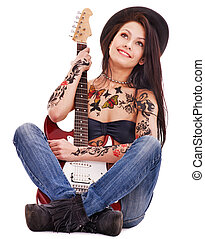 Girl with tattoo playing guitar - Young woman with tattoo...