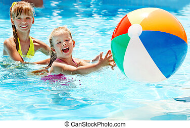 Children swimming in pool - Little girl swimming in pool