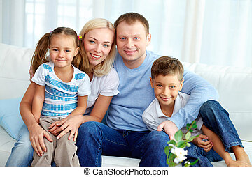 Family at home - Portrait of happy family with two children...