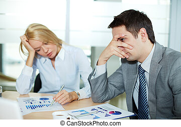 Difficult topic - Sad business partners at workplace, focus...