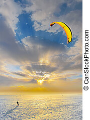 kite surfing - kiting in the winter, the snow Gulf at sunset