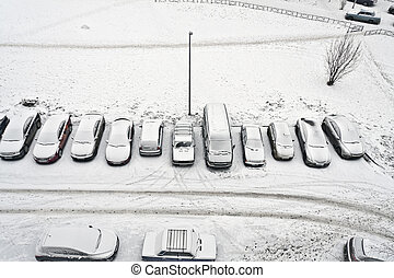 cars snowbound morning in the courtyard, in the winter