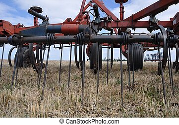 Farm cultivator in a field - A close-up view of a farm...