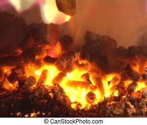 flame burn straw pellet - closeup of burn straw pellets in...