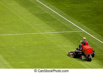 Mowing Grass - Mowing grass in a football stadium